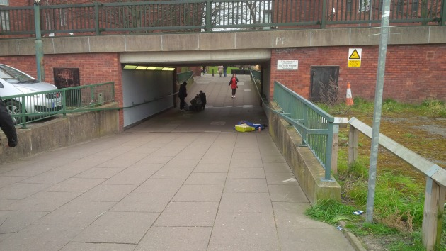 """The sign says """"In the interests of safety, cyclists please dismount."""" What is so unsafe in having a cycle lane on one side of this underpass and through St James Square?"""